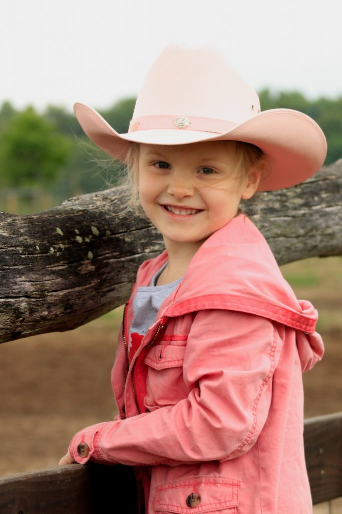 This little cowgirl loves checking cattle and watching the cowboys work cattle.